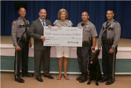 At their August meeting, the Leisure Village West Pet Club donated $1,000 to the Manchester Township Police Foundation for the Police K-9 Unit. Lt. James Sharkey, Mayor Kenneth Palmer, K-9 Officer Marc Micciulla, K-9 Storm, and Lt. Vincent Manco (pictured with Mrs. Gormley) attended the meeting and expressed their appreciation to the Pet Club members for their support. Donations like these help offset the cost of care and training for the K-9 Unit.    (Photo courtesy of A. Goldberg).